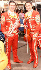 image of two mariachis in red suits