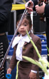Young girl in mariachi suit
